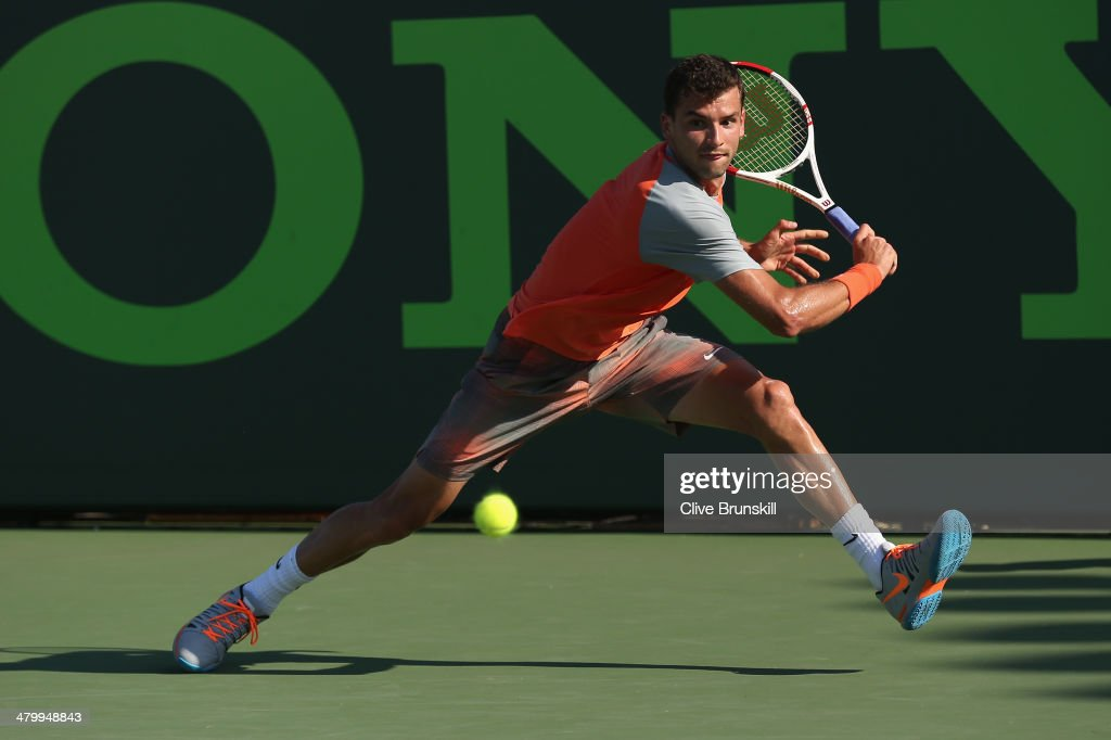 <a gi-track='captionPersonalityLinkClicked' href=/galleries/search?phrase=Grigor+Dimitrov&family=editorial&specificpeople=4332557 ng-click='$event.stopPropagation()'>Grigor Dimitrov</a> of Bulgaria runs to play a backhand against Albert Montanes of Spain during their second round match during day 5 at the Sony Open at Crandon Park Tennis Center on March 21, 2014 in Key Biscayne, Florida.