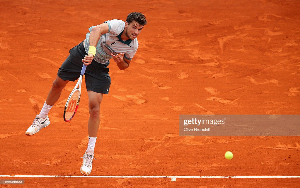 <a gi-track='captionPersonalityLinkClicked' href=/galleries/search?phrase=Grigor+Dimitrov&family=editorial&specificpeople=4332557 ng-click='$event.stopPropagation()'>Grigor Dimitrov</a> of Bulgaria serves against Rafael Nadal of Spain in their quarter final match during day six of the ATP Monte Carlo Masters, at Monte-Carlo Sporting Club on April 19, 2013 in Monte-Carlo, Monaco.