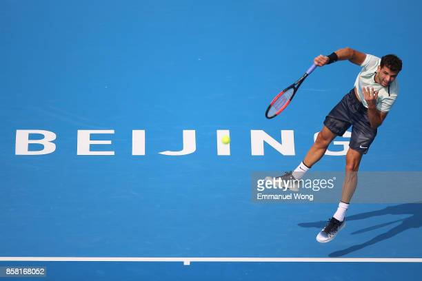 Grigor Dimitrov of Bulgaria serves against Roberto Bautista Agut of Spain during the Men's Quarterfinal match on day seven of the 2017 China Open at...