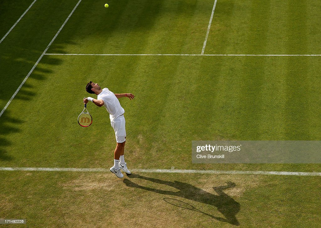 Grigor Dimitrov of Bulgaria serves during his Gentlemen's Singles first round match against Simone Bolelli of Italy on day two of the Wimbledon Lawn Tennis Championships at the All England Lawn Tennis and Croquet Club on June 25, 2013 in London, England.