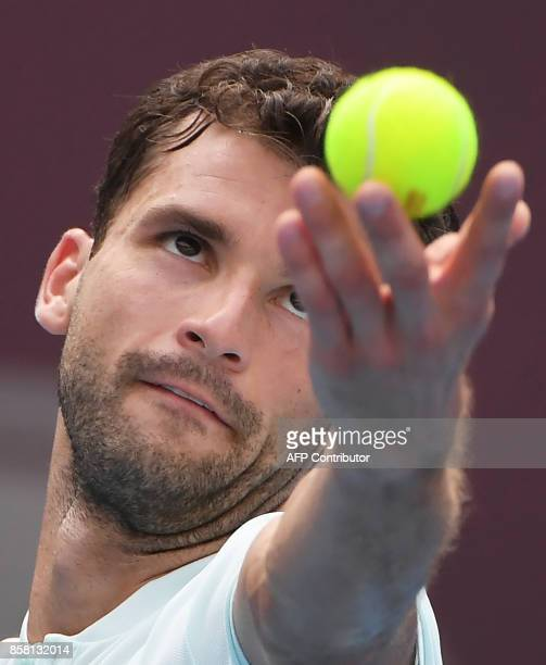 Grigor Dimitrov of Bulgaria serves during his men's singles quarterfinal against Roberto Bautista Agut of Spain at the China Open tennis tournament...