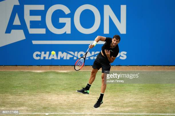 Grigor Dimitrov of Bulgaria serves during the mens singles quarter final match against Daniil Medvedev of Russia on day five of the 2017 Aegon...