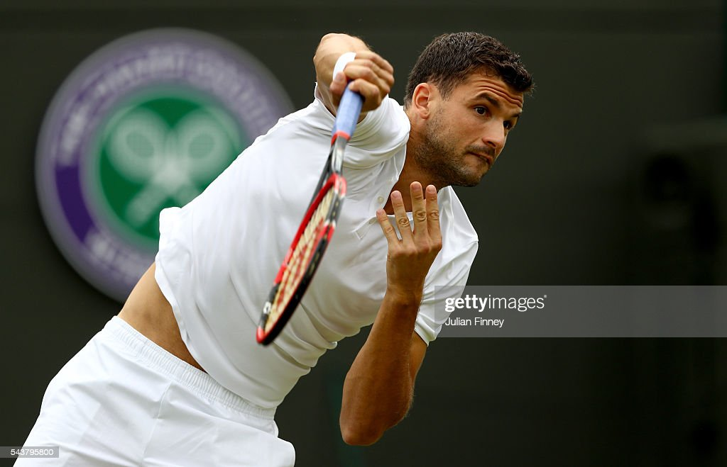 Grigor Dimitrov of Bulgaria serves during the Men's Singles second round match against Gilles Simon of France on day four of the Wimbledon Lawn Tennis Championships at the All England Lawn Tennis and Croquet Club on June 30, 2016 in London, England.
