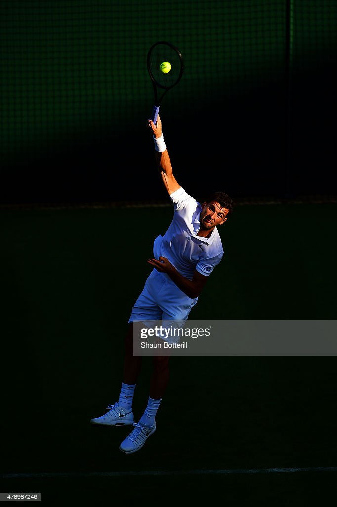 Grigor Dimitrov of Bulgaria serves in his Gentlemens Singles first round match against Federico Delbonis of Argentina during day one of the Wimbledon Lawn Tennis Championships at the All England Lawn Tennis and Croquet Club on June 29, 2015 in London, England.
