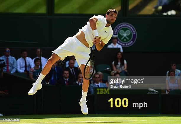 Grigor Dimitrov of Bulgaria serves in his Gentlemen's Singles Third Round match against Richard Gasquet of France during day five of the Wimbledon...