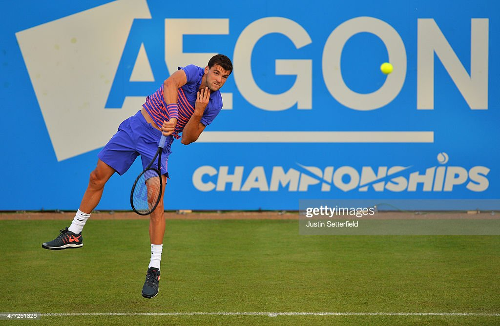 Grigor Dimitrov of Bulgaria serves in his men's singles first round match against Sam Querrey of USA during day one of the Aegon Championships at Queen's Club on June 15, 2015 in London, England.