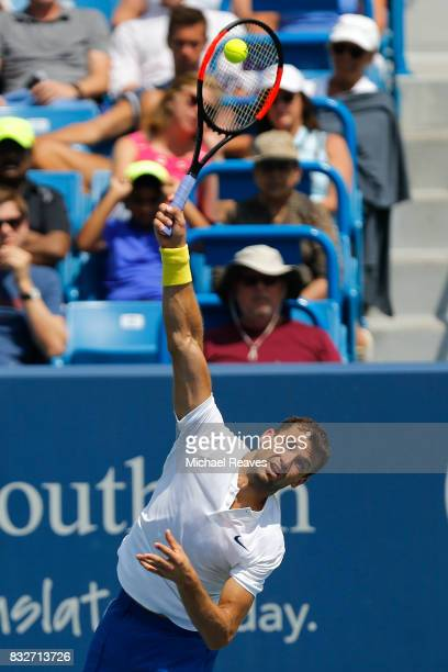 Grigor Dimitrov of Bulgaria serves to Feliciano Lopez of Spain during Day 5 of the Western and Southern Open at the Lindner Family Tennis Center on...