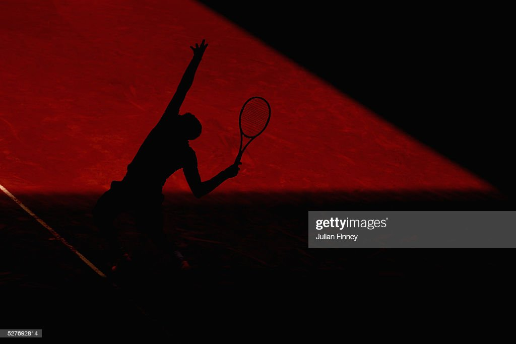 Grigor Dimitrov of Bulgaria serves to Pablo Carreno Busta of Spain during day four of the Mutua Madrid Open tennis tournament at the Caja Magica on May 03, 2016 in Madrid, Spain.
