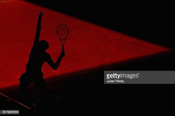 Grigor Dimitrov of Bulgaria serves to Pablo Carreno Busta of Spain during day four of the Mutua Madrid Open tennis tournament at the Caja Magica on...