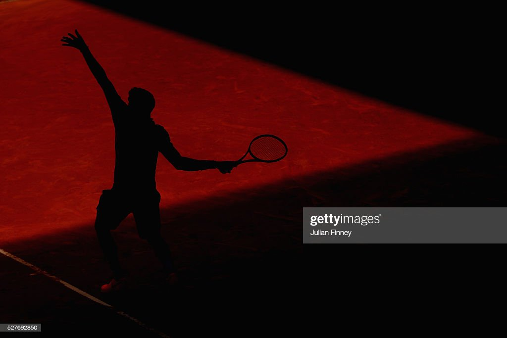 <a gi-track='captionPersonalityLinkClicked' href=/galleries/search?phrase=Grigor+Dimitrov&family=editorial&specificpeople=4332557 ng-click='$event.stopPropagation()'>Grigor Dimitrov</a> of Bulgaria serves to Pablo Carreno Busta of Spain during day four of the Mutua Madrid Open tennis tournament at the Caja Magica on May 03, 2016 in Madrid, Spain.