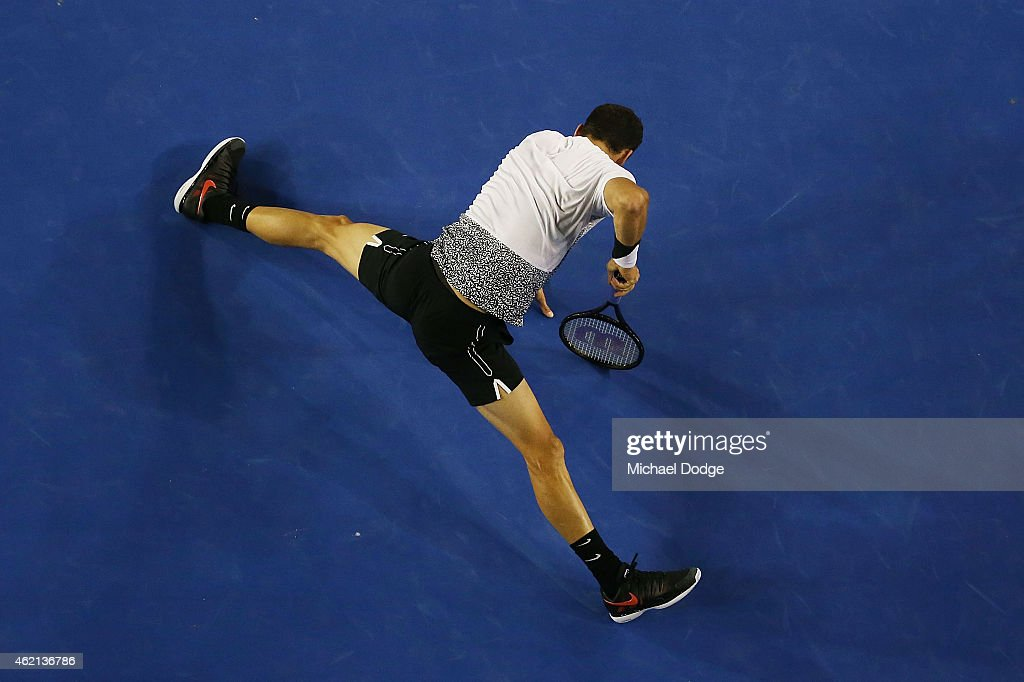 Grigor Dimitrov of Bulgaria slips over in his fourth round match against Andy Murray of Great Britain during day seven of the 2015 Australian Open at Melbourne Park on January 25, 2015 in Melbourne, Australia.