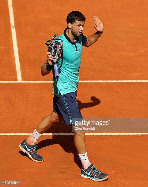 Grigor Dimitrov of Bulgaria smashes his racket against Rafael Nadal of Spain in their quarter final match during day seven of the Mutua Madrid Open...