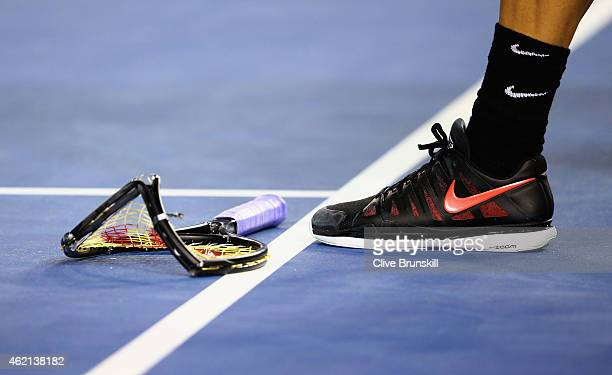 Grigor Dimitrov of Bulgaria smashes his racket in his fourth round match against Andy Murray of Great Britain during day seven of the 2015 Australian...