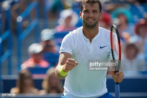 Grigor Dimitrov of Bulgaria smiles after winning his semifinal match against John Isner of the United States in the Western Southern Open at the...