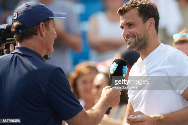 Grigor Dimitrov of Bulgaria smiles while being interviewed after winning his semifinal match against John Isner of the United States in the Western...