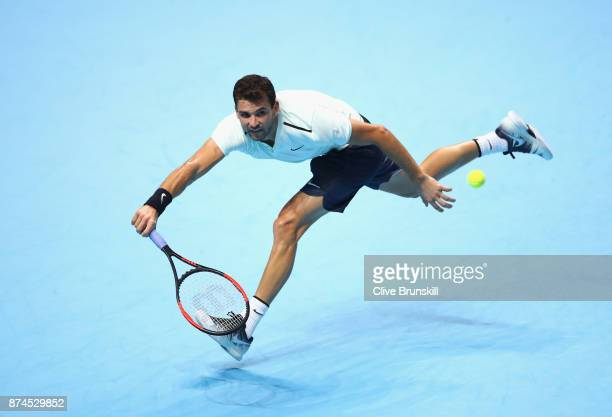 Grigor Dimitrov of Bulgaria stretches for a forehand during the singles match against David Goffin of Belgium on day four of the 2017 Nitto ATP World...