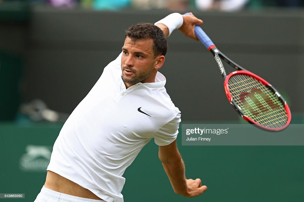 Grigor Dimitrov of Bulgaria stretches for the ball during the Men's Singles second round match against Gilles Simon of France on day four of the Wimbledon Lawn Tennis Championships at the All England Lawn Tennis and Croquet Club on June 30, 2016 in London, England.