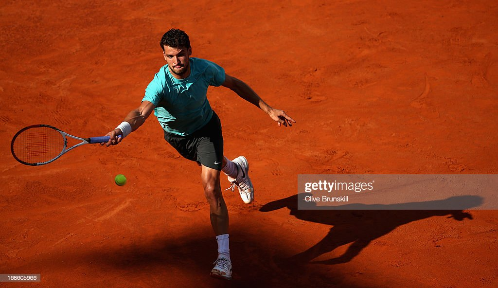 <a gi-track='captionPersonalityLinkClicked' href=/galleries/search?phrase=Grigor+Dimitrov&family=editorial&specificpeople=4332557 ng-click='$event.stopPropagation()'>Grigor Dimitrov</a> of Bulgaria stretches to play a forehand against Marcos Baghdatis of Cyprus in their first round match during day one of the Internazionali BNL d'Italia 2013 at the Foro Italico Tennis Centre on May 12, 2013 in Rome, Italy.