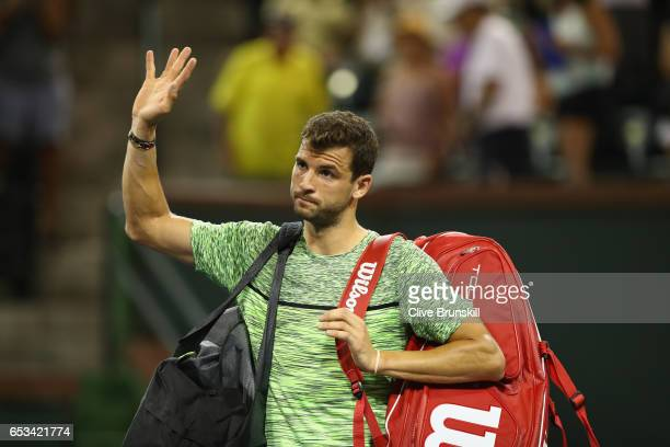 Grigor Dimitrov of Bulgaria waves to the crowd after his three set defeat by Jack Sock of the United States in their third round match during day...