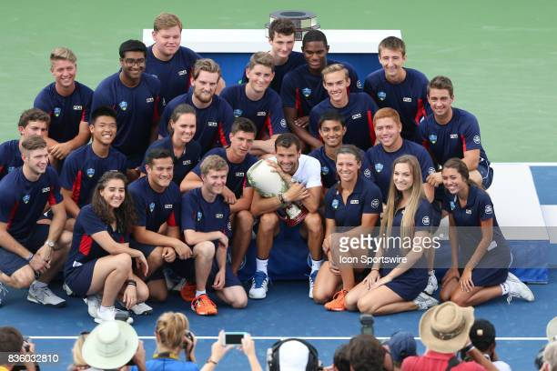 Grigor Dimitrov poses with the ball boys and ball girls after the championship match at the Western Southern Open at the Lindner Family Tennis Center...