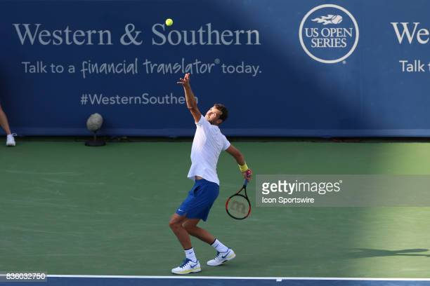 Grigor Dimitrov serves during the championship match against Nick Kyrgios during the Western Southern Open at the Lindner Family Tennis Center in...