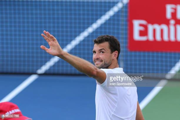Grigor Dimitrov waves to fans after winning the championship match against Nick Kyrgios during the Western Southern Open at the Lindner Family Tennis...