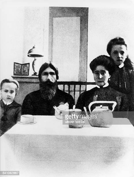 Grigori Rasputin *22011869monk faith healer Russia with Tsarina Alexandra Romanov and her son Alexei at the Alexander Palace in St Petersburg Russia...