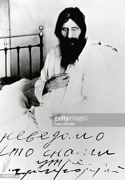 Grigori Rasputin poses for a photograph on his hospital bed some time after he was injured during an assassination attempt on his life on June 29...
