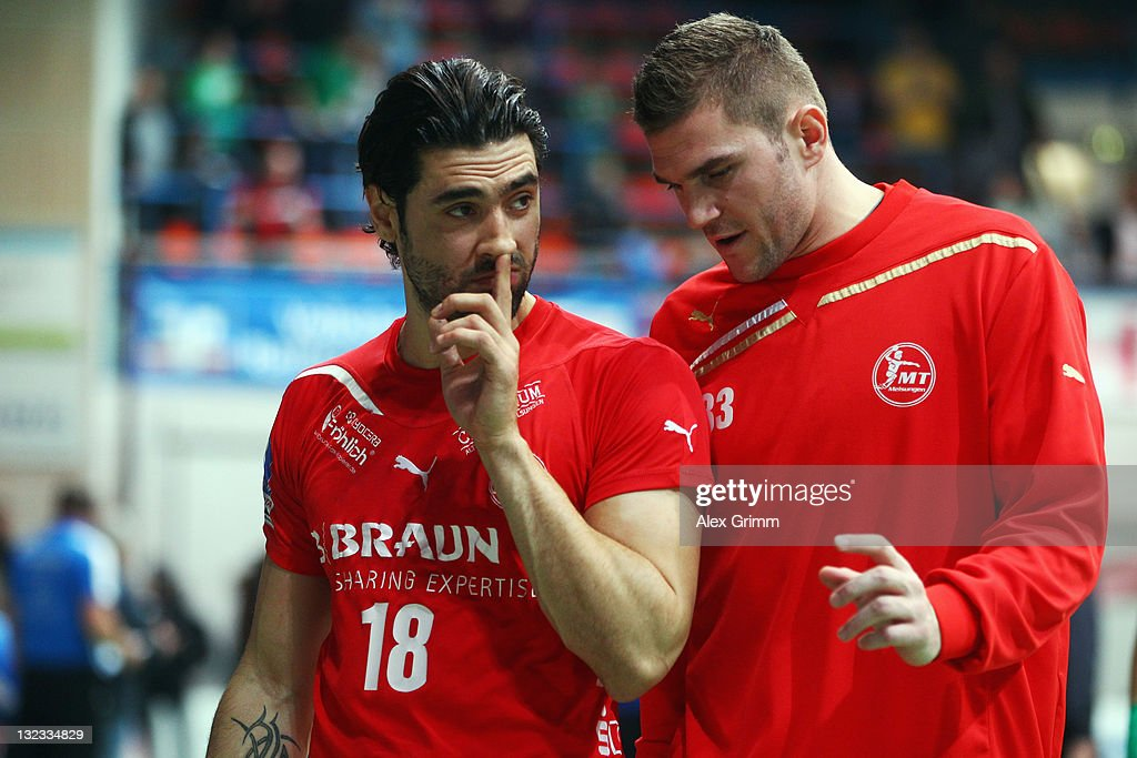 Grigorios Sanikis (L) and Alin Florin Sania of Melsungen react after the Toyota Handball Bundesliga match between T VGrosswallstadt and MT Melsungen at f.a.n. frankenstolz arena on November 11, 2011 in Aschaffenburg, Germany.