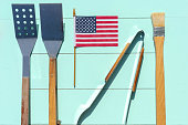 Cook out flat lay - American flag and grill tools for holiday barbecue