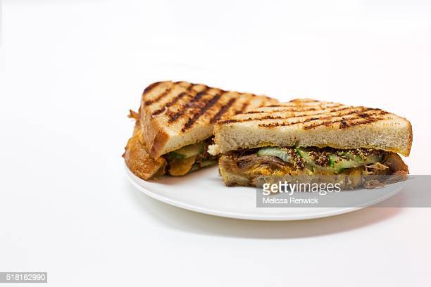 TORONTO ON MARCH 24 A grilled cheese on white bread with cheddar cheese cucumber pickles grainy mustard and pulled pork shoulder is pictured