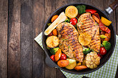 Grilled chicken breast and vegetables in the pan