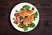 Grilled chicken breast and vegetable salad, top view