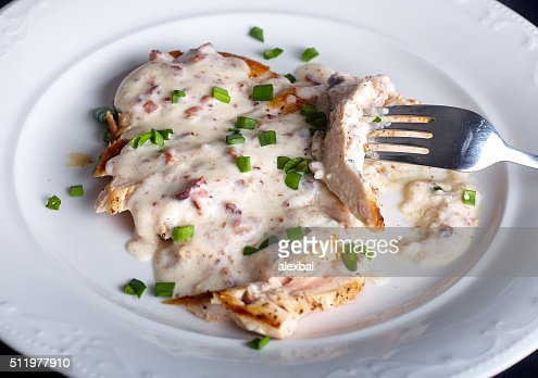 Grilled chicken breast with cheese sauce : Stock Photo