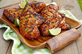 Grilled chicken breast served with herbs and lime