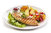 Grilled chicken fillet with potatoes and vegetables salad