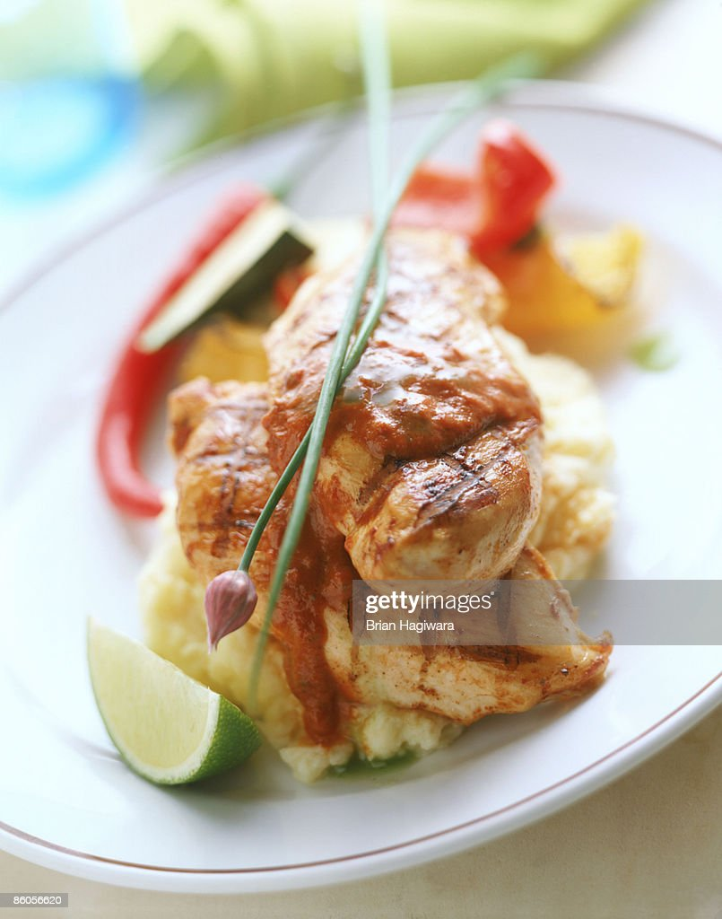 Grilled chicken breast with tomato chili sauce : Stock Photo