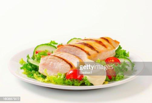 grilled chicken breast with vegetable garnish