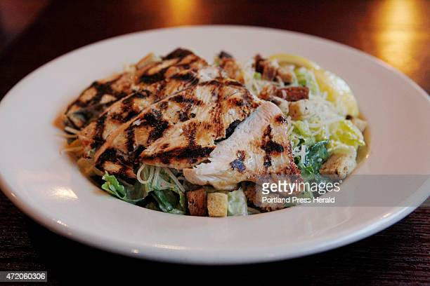 A grilled chicken caesar salad is seen Thursday April 30 2015 at Bistro 233 in Yarmouth Maine