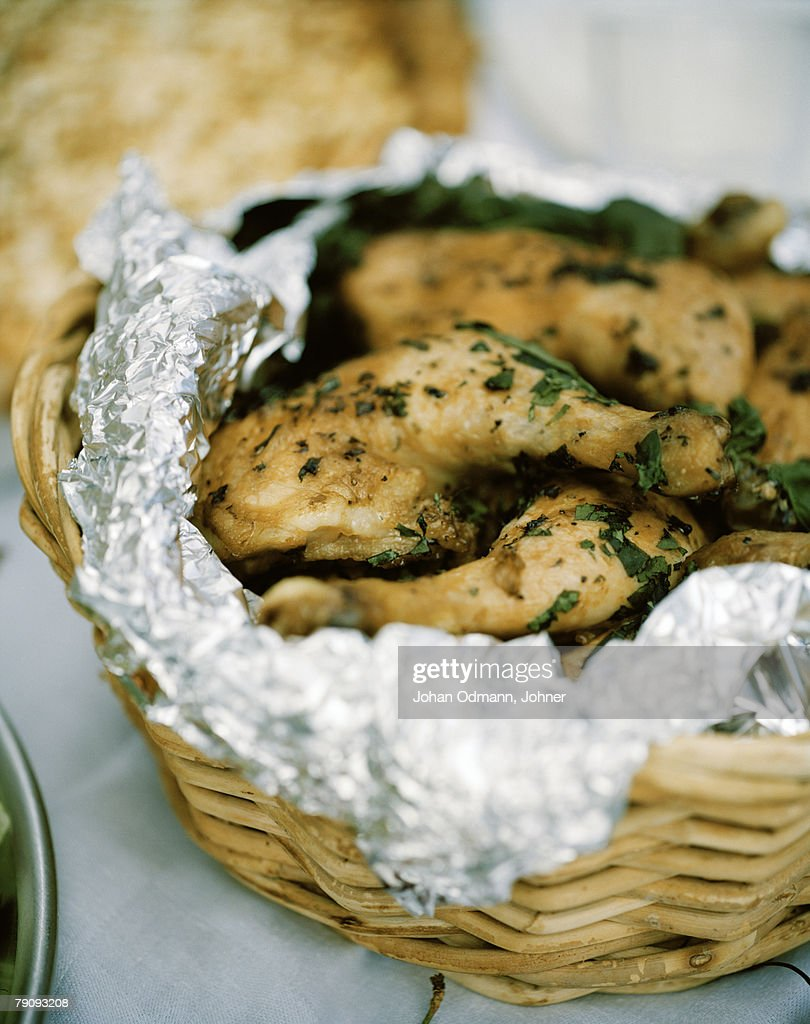 Grilled chicken in a basket. : Stock Photo