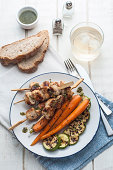 Grilled chicken meat with glazed carrots