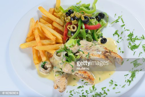 Grilled chicken with french fries : Stock Photo