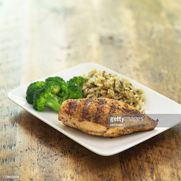 Grilled chicken with rice and broccoli on a plate