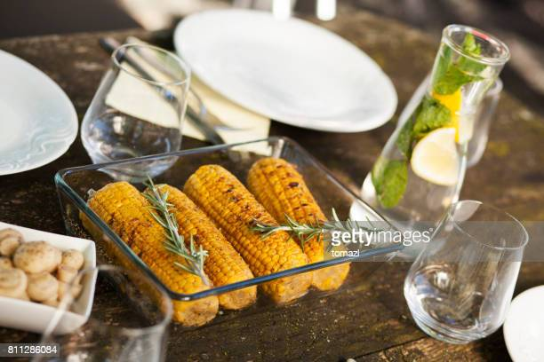 Grilled corn at a picnic table