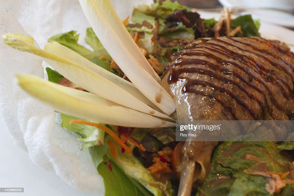 Grilled duck leg on salad : Stock Photo