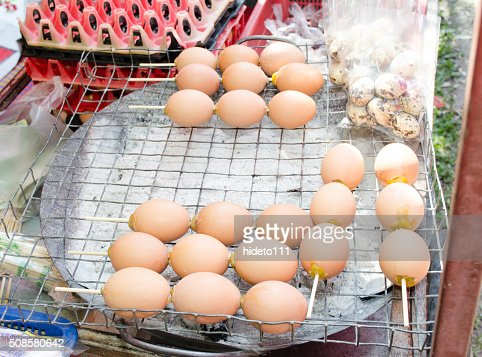 Grilled eggs ; eggs on the grill : Stock Photo