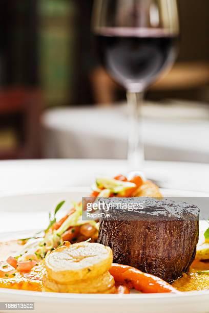 Grilled fillet steak, vegetables, red wine: the perfect restaurant meal