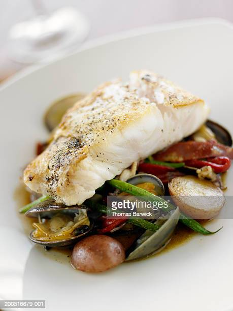 Grilled halibut with clams, green beans, red peppers and red potatoes
