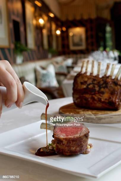 WASHINGTON VA Grilled King Lamb Chop Perfumed with Rosemary on Summer Cassoulet with Minted Bearnaise at the Inn at Little Washington in Washington VA
