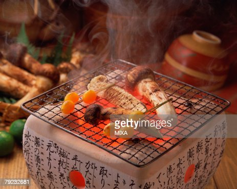 Grilled matsutake mushrooms : Stock Photo